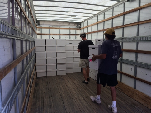Figure 11. DNR archaeologists Sean Taylor and Tariq Ghaffar move the DNR archive to the SC State Museum (Tuesday, August 30, 2016). Image Credit: Meg Gaillard/SCDNR.