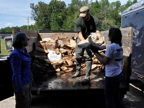 Figure 3. Unloading boxes of artifacts at SCDNR Styx Receiving Compound and Fish Hatchery (Thursday, October 4, 2015). Image Credit: Meg Gaillard/SCDNR.