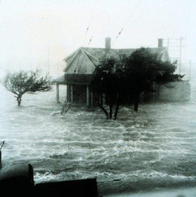 NOAA Image US Navy Photo Storm Surge pushing water ashore during a hurricane.